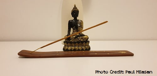 decorating a yoga meditation altar with incense or statues